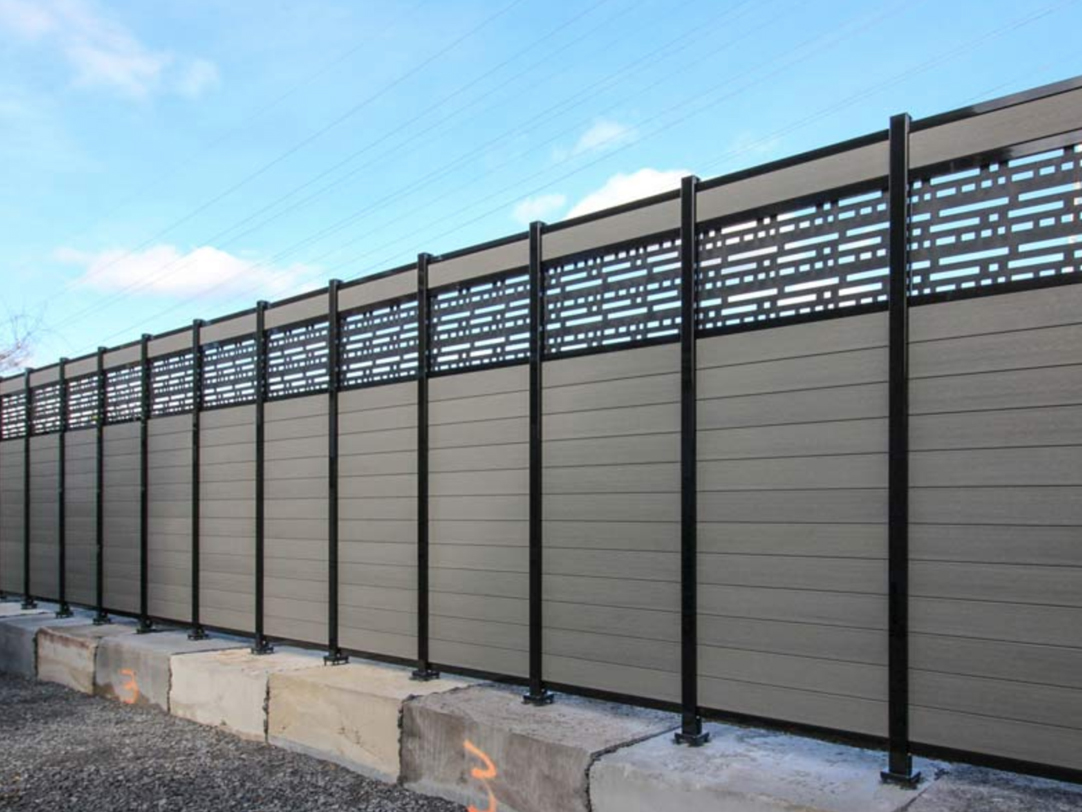 Grey and black composite fence installation